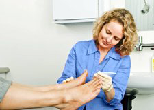 A healthcare professional examines a foot during an annual foot check