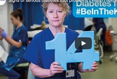Clinical member Maureen holds up the number 14