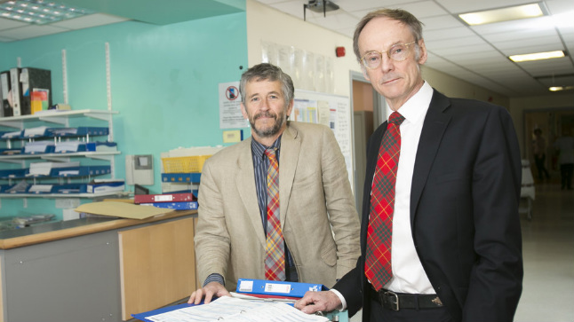 Scientists Mike and Roy standing next to eachother