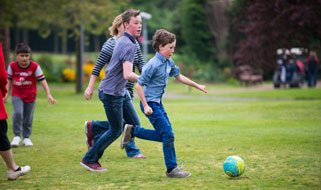 children-playing-football-321x190.jpg