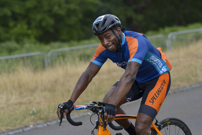 Man cycling and smiling