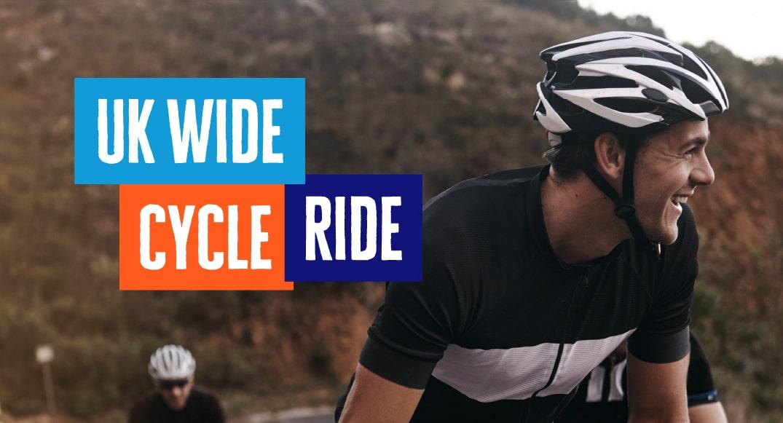 A man smiles as he rides a bike