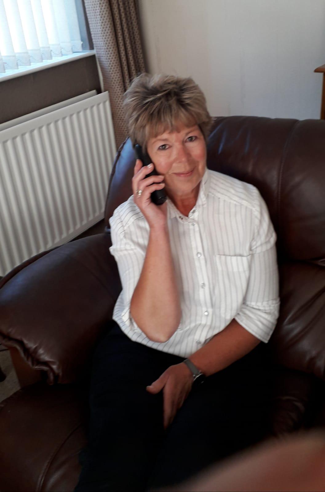 Befriender volunteer Roberta McCullough on a telephone call