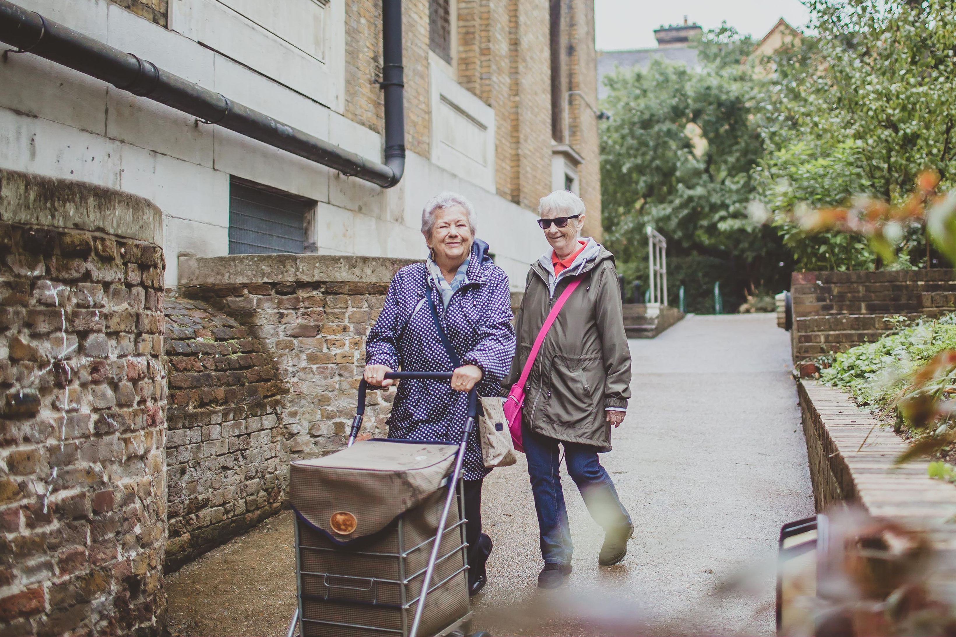 Two older ladies walking together