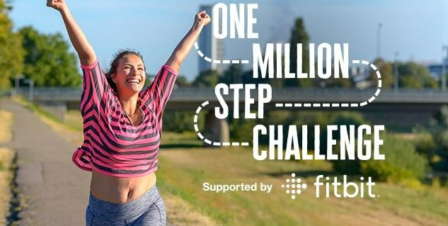 A lady celebrating completing her million steps for the Diabetes UK One Million Step walking challenge