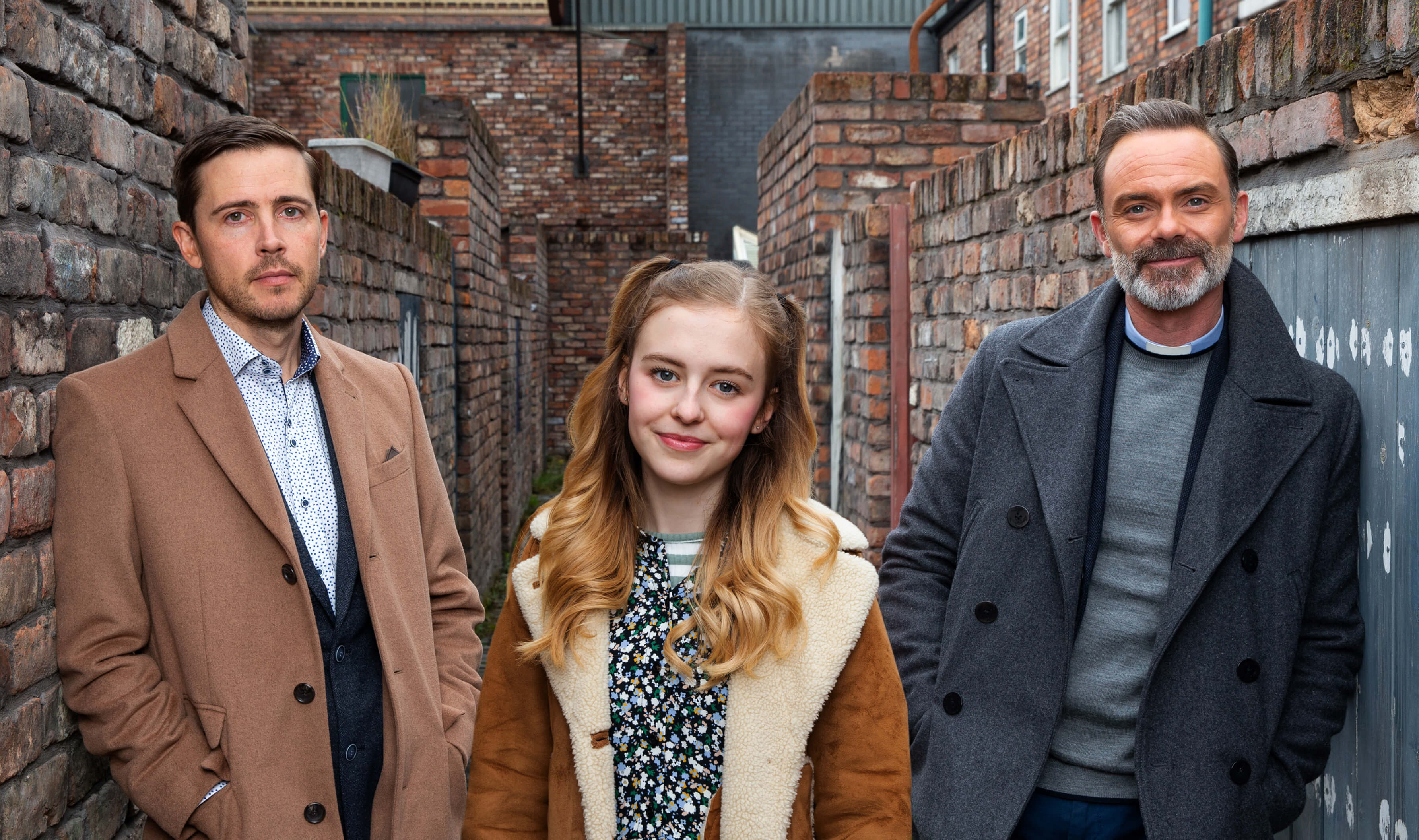 Todd, Summer and Billy from Coronation Street stand on set