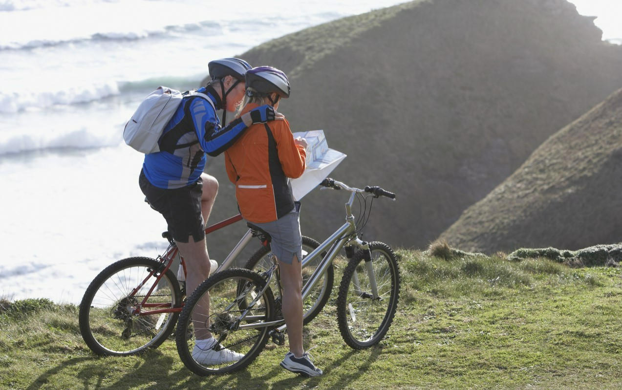 Two cyclists checking their map on the UK Wide Cycle Ride challenge journey