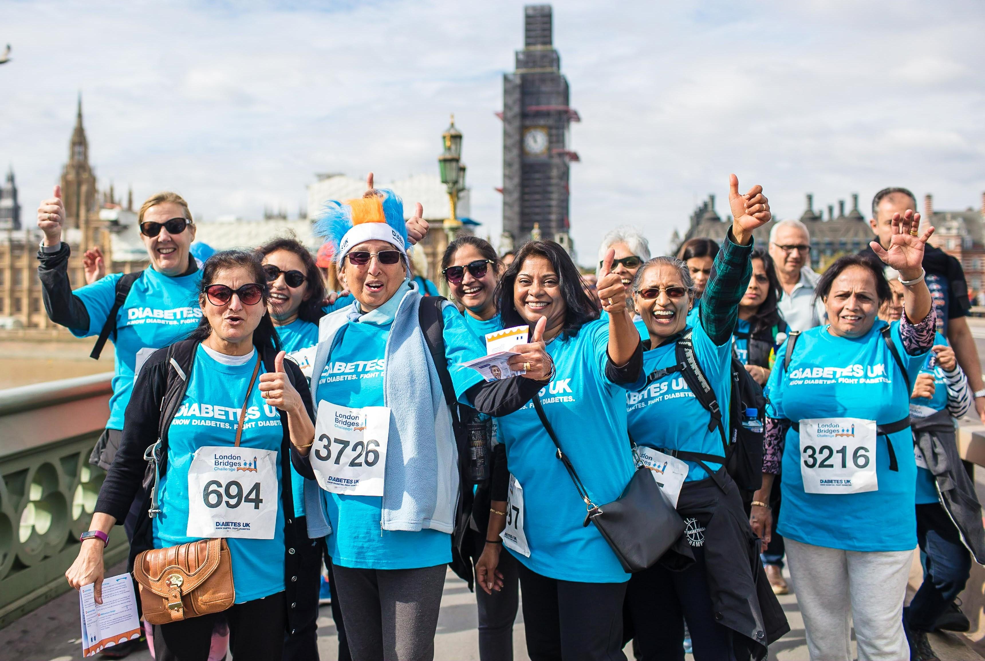 Group of people waving at Diabetes UK London Bridges event
