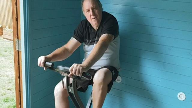 Darren Armitstead exercising on bike.jpg