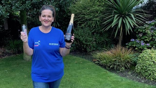 Helen celebrating finishing her one million steps