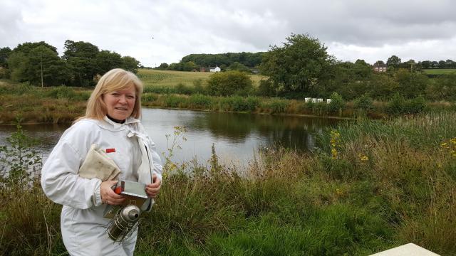 Deborah wearing a beekeeper suit