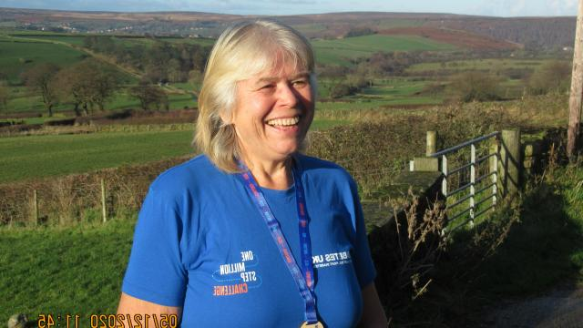 Jan smiling in her One Million Step Challenge t-shirt and medal