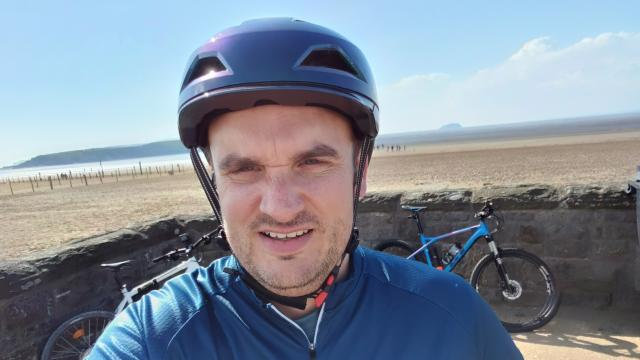 Jamie smiling as he takes on his UK Wide Cycle Ride challenge