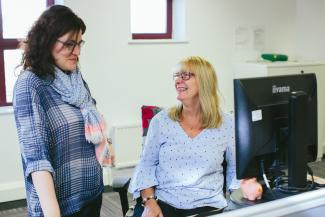 Two colleagues in the Diabetes Scotland office chatting