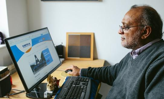 Image of man using a computer