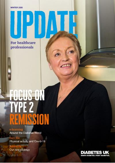Front cover of winter edition f Update, featuring a woman smiling to camera while in her kitchen