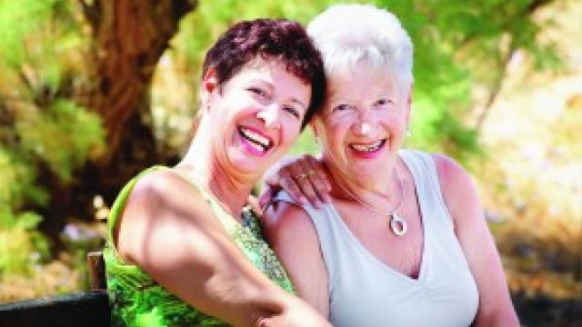 Two older ladies smiling together