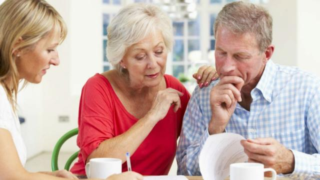 Older couple looking at a document sitting at a table