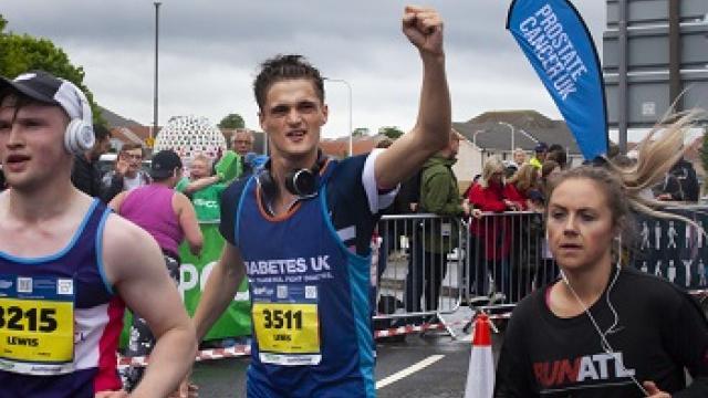 Man running along race route