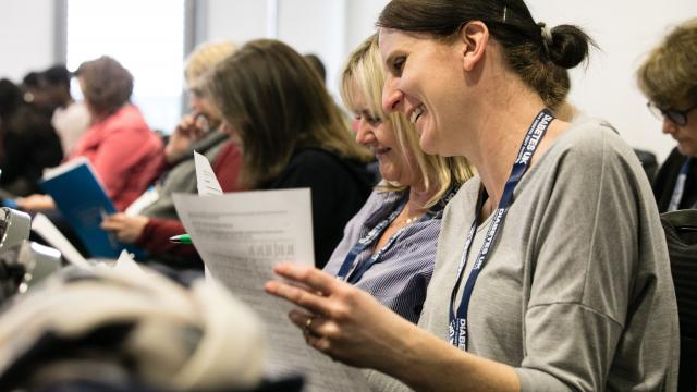 Lady smiling as she attends a leadership programme