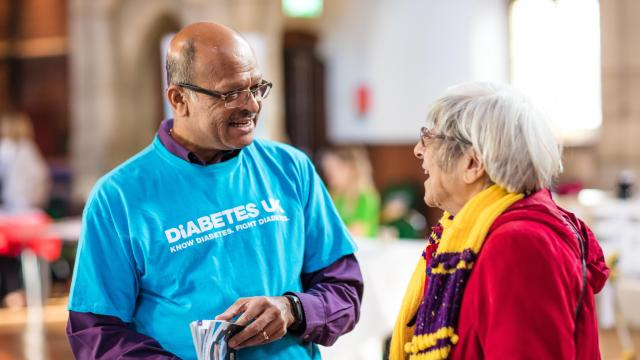Rohit, a Diabetes UK volunteer, chatting to another volunteer at an event