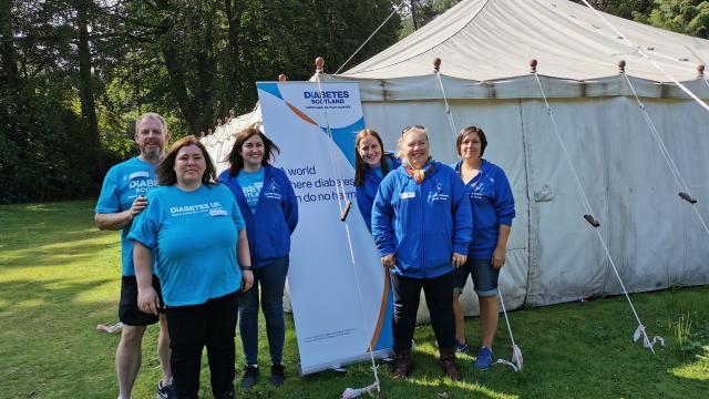 Diabetes UK volunteers smiling at the camera