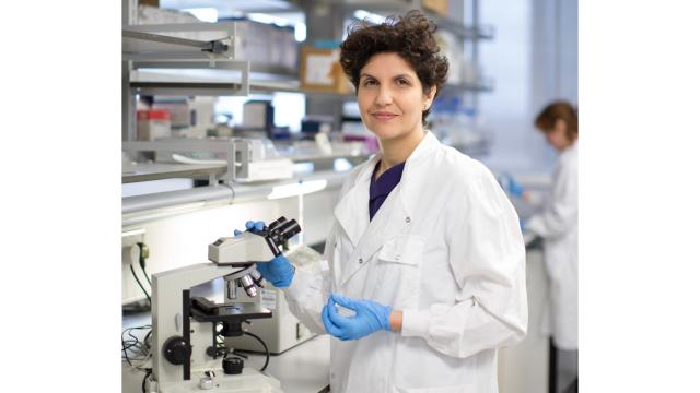 A researcher stands in a lab