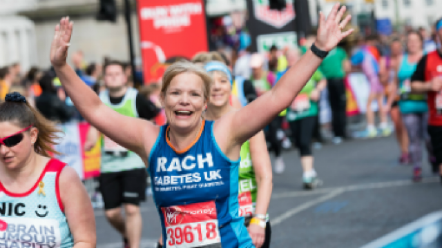A lady running for Diabetes UK at a running event