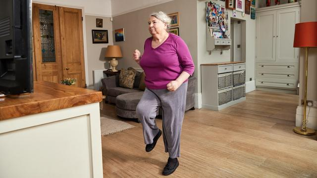 A lady stepping on the spot as she takes part in the Diabetes UK Get Moving course