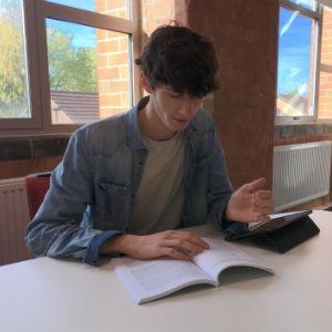Tom studying at university