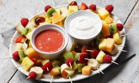 Skewered fruit with dipping sauces