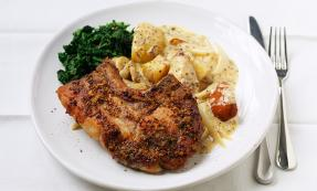 Pork chops with roasted pear, apple and new potatoes