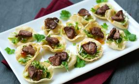 Spicy duck topped poppadoms