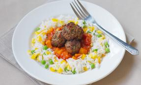 Sweet and sour meatballs with veggie rice
