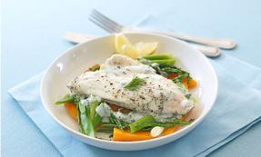 Poached plaice with spring onion and baby carrots