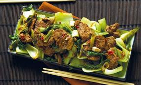 Spicy ginger and garlic pork with pak choi